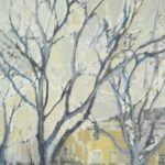 grey day, bare trees, yellow buildings in background