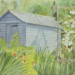 Grey shed surrounded by tall flowers and plants