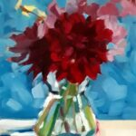 red flowers in a glass vase against bright blue backdrop. Effect is that everything is slightly out of focus