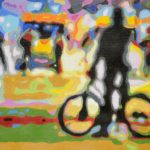 neon street scene with black silhouette of figure with bike