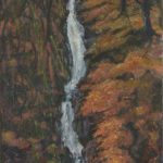 waterfall flowing through autumnal scene