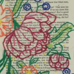 Flowers stitched across a page of a book