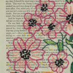 flowers embroidered onto page of a book