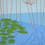 Lily pads on a pond with tall reeds