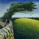stone wall next to green field, tree blowing at sharp angle across both