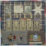 textile of 5 houses and a family walking