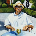 Old man in white shirt and hat sitting at a table in the sun with beer and plates of food