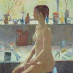 nude woman sitting on a stool in a workroom, in profile