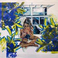 woman sitting on ground amongst green and blue plants