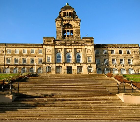 image of Wallasey Town Hall , looking up the steps against a sunny blue sky