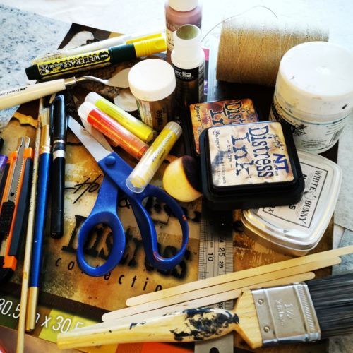 selection of art tools like scissors, string and paintbrushes