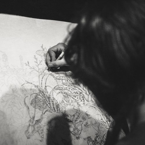 Woman sketching a flower in black and white