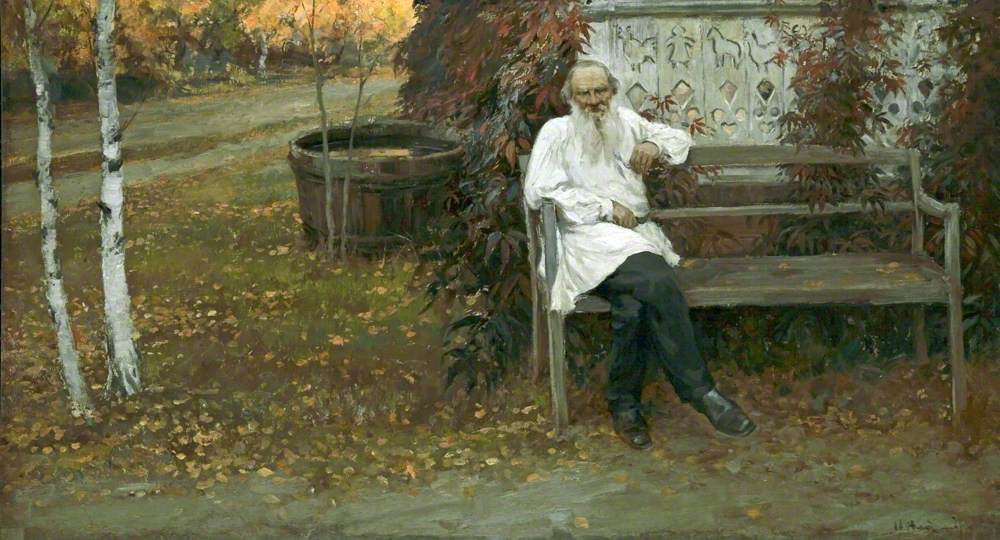 Landscape painting of Leo Tolstoy sitting on a garden bench. He is dressed in a long white peasant blouse and has a white beard. On the left hand side are two silver birches.