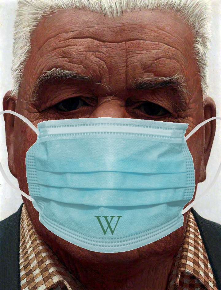 An image of a portrait by Geoff Yeomans of a man's face, photoshopped to be coverd be a blue facemask with a W on it.